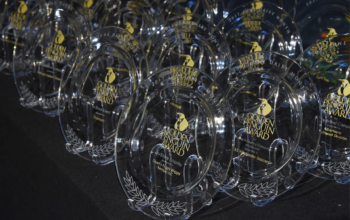 Golden Penguin Awards on table