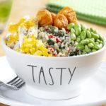 quinoa, corn, edamame in white bowl on plate