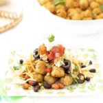 Tater tots with toppings on plate